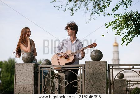 Romantic city date couple guitar music concept. Serenade for beloved. Happy together.