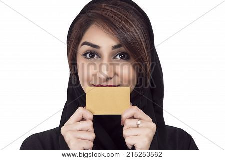 Arab Female holding golden card focus on the debit card over white background