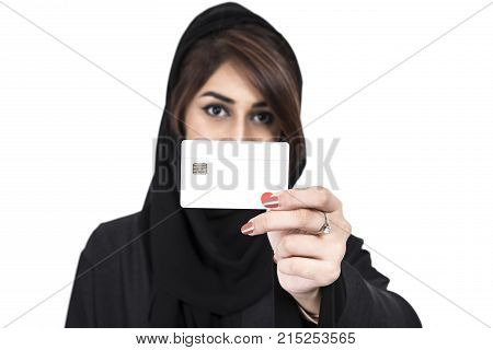 Arab Female holding credit card focus on the debit card over white background