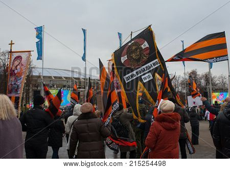 November 4 2017 Moscow Russia. Representatives National Liberation Movement (NOD) with flags and icons at the Luzhniki Stadium in Moscow.