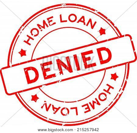 Grunge red home loan denied word round rubber seal stamp on white background