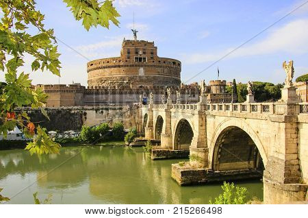 Saint Angel Castle and Saint Angel bridge over the Tiber river in Rome Italy.