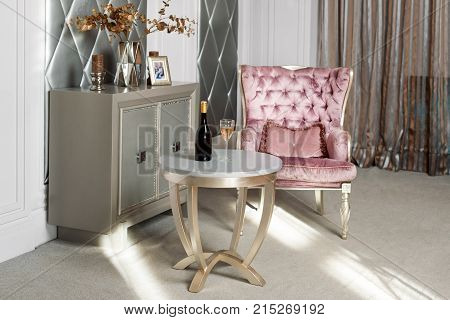 Luxury Interior. Luxurious Pink Velvet Armchair, Antique Carved Furniture, Classic Interior. Served