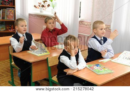 Gadjievo, Russia - September 2, 2010: First graders are ready to answer the question