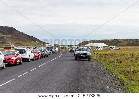 Car Parking At Roadside Of Country Road In Iceland