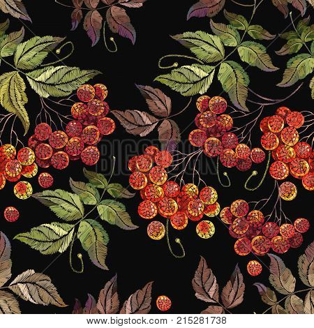 Embroidery red branches of a mountain ash. Fashionable template for design of clothes. Classical embroidery red berries of mountain ash art pattern