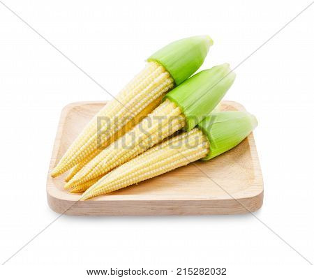 Fresh baby corns in wooden dish isolated on white background Save clipping path.