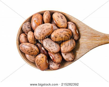 Raw Organic cranberry bean in wooden spoon isolated on white background (pinto bean) Saved clipping path.