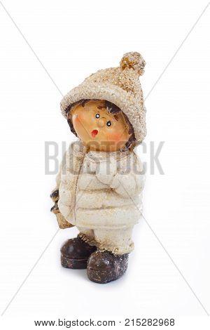 Cute christmas figurine winter edition. Cute little boy with warm coat.