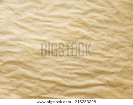 Crumpled brown waxed used bakery paper texture