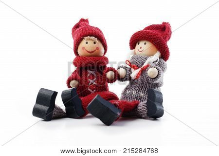 Cute christmas couple figurines on isolated white studio background. Valentines concept.