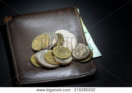 Close up of Thailand money bath with wallet on white background - Banknote and coins