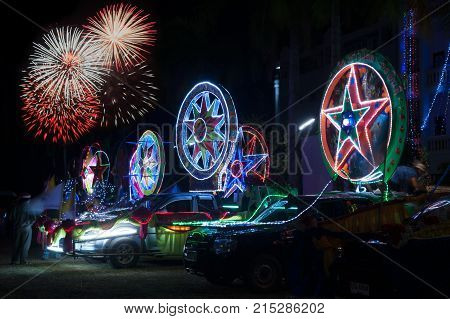 SAKON NAKHON, THAILAND - DEC 25, 2015 :Firework at the celebrating Christmas with the dazzling star parade on more than 200 cars together with a Santa Claus and angels parade in Parade of Christmas Star Festival.