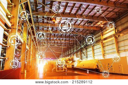 Industry 4.0 concept image. industrial instruments in the factory with cyber and physical system icons Internet of things networksmart factory solution