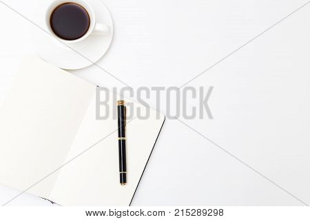 Office desk with a notebook and a cup of coffee. Mockup