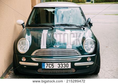 Cesky Krumlov, Czech Republic - September 26, 2017: Front View Of Youth Stylish Hipster Green Color Mini Cooper Car Parking On Street.
