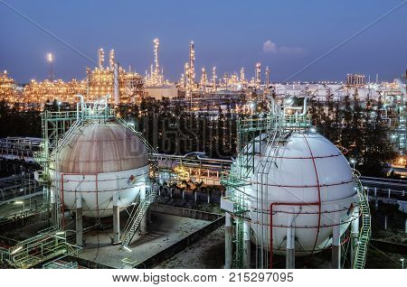 Gas storage sphere tanks in oil and gas refinery industry or petrochemical plant with twilight time