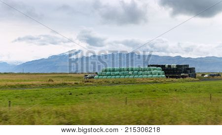 Icelandic Country Landscape With Haystacks In Field
