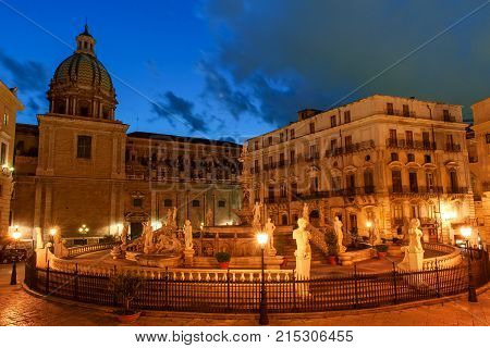 Palermo Sicily Italy - night view of Fountain of shame on baroque Pretoria square at night blue hour