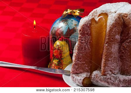 pandoro, traditional italian Christmas cake, from Verona, italy, with decoration on red backcloth