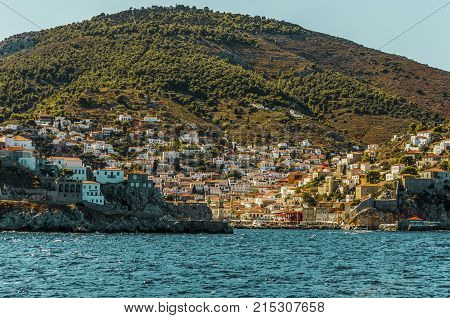sailing through the Saronic sea and arrival at the port of the island of hydra with the buildings surrounding it down the mountain