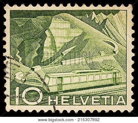 Moscow Russia - November 25 2017: A stamp printed in Switzerland shows mountain railway at Rocher de Naye series