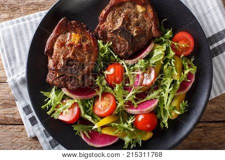 Roasted Hot Lamb Steak And Fresh Vegetable Salad Close-up On A Plate. Horizontal Top View