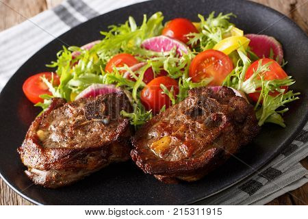 Roasted Lamb Steak And Salad From Radish, Tomatoes, Pepper And Lettuce Close-up. Horizontal