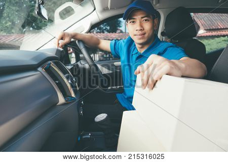 Delivery Driver And Packages On Seat.