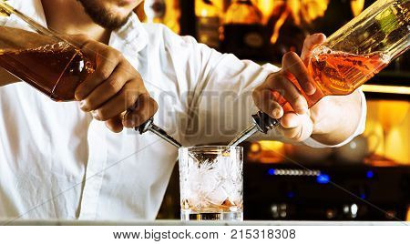 Professional At The Bar Prepares Mixed Drinks For His Guests.