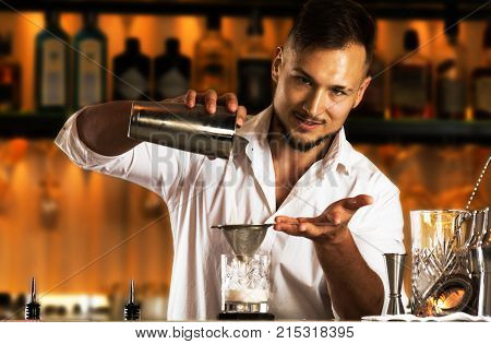 Charming Bartender Prepares A Delicious Cocktail For His Guest.