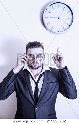 You're Late! Angry Businessman Is Pointing At  Clock Suggesting You Are Late For Work. (work, Respon