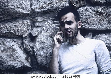 The Bad News Negative Emotions Concept. Nervous Man Swearing Into His Mobile Phone.