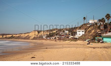 Condemned old Beach cottages line Crystal Cove State Park beach and are right on the sand with an ocean view in Newport Beach California