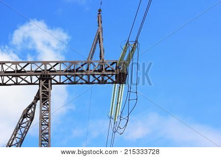 Line of electric transmission against the blue sky