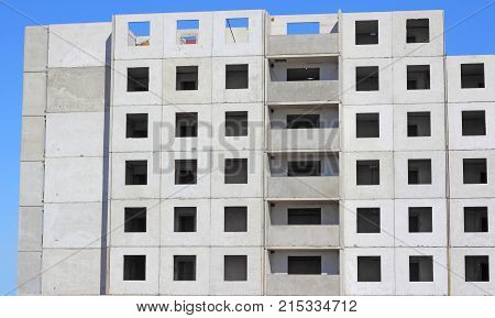 Unfinished house on a brick building, blue sky
