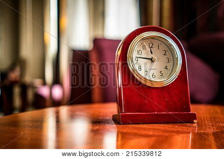 Old Fashioned wooden clock in boudoir vintage style ambiance - time pass concept