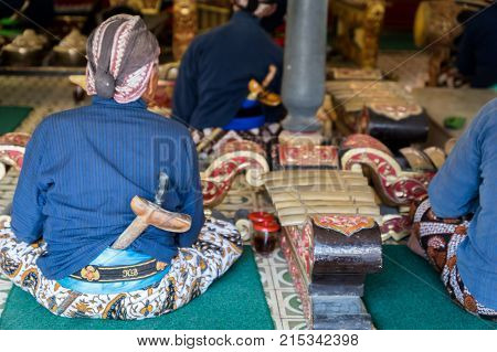 Yogyakarta, Indonesia - October 2017: Musicians perfoming Gamelan music at King's palace in Yogyakarta, Indonesia. Gamelan is a traditional music in Java and Bali in Indonesia.