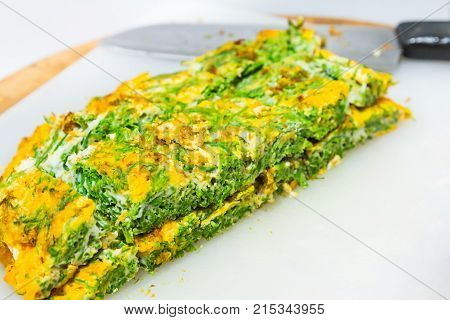 Climbing wattle (Cha-om) omelette cutting into rectangular pieces