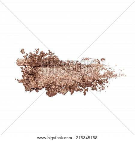 Eyeshadow sample isolated on white background. Crushed brown metallic eyeshadow. Closeup of a makeup product.