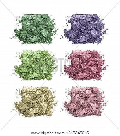 Set of eyeshadow sample isolated on white background. Crushed green, purple, pink and violet metallic eyeshadow. Closeup of a makeup product.