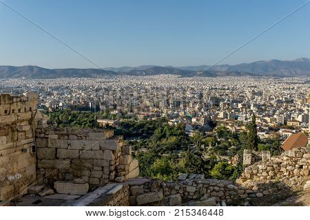 Photo from famous Lycabettus hill to Athens center with temple ruins in the foreground