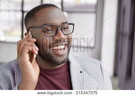 Close Up Portrait Of Cheerful Male With Dark Pure Healthy Skin, Has Broad Smile, Shows Perfect Teeth