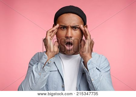 Horrified Stunned Mixed Race Male Openes Mouth Widely, Can`t Undertand What Happend, Has Puzzled Exp