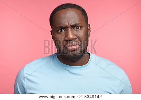 Portrait Of Discontent Black Male Frowns Face In Displeasure Being Unhappy To Recieve Bad News Or Af