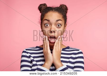 Portrait Of Shocked Woman With Dark Skin And Two Hair Knots, Being Surprised Or Astonished To See La