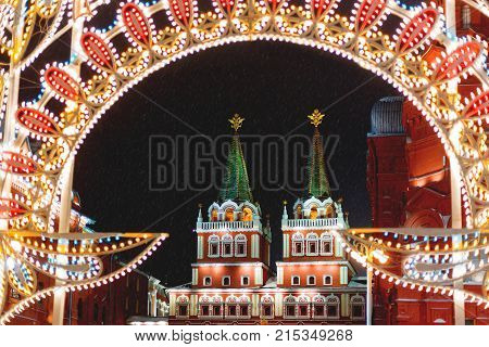 Historic center of Moscow decorated to New Year and Christmas celebration. Resurrection gate entrance on Red Square. Winter snowy evening. Russia.
