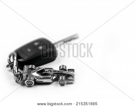 car key and key chain on white background