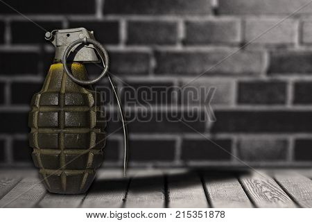 hand bomb on wooden floor with background wall