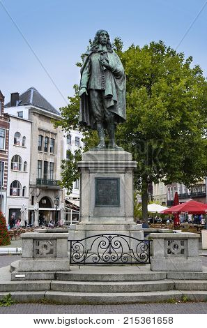 The Hague The Netherlands - August 18 2015: A statue of Johan de Witt stands in the middle of the square De Plaats in The Hague Netherlands on August 18 2015.